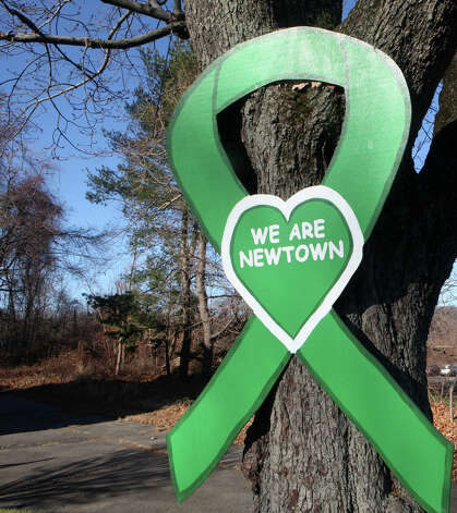 Many businesses continue to display signs of support in Newtown on Sunday, Nov. 24, 2013. Photo: Unknown, B.K. Angeletti / Connecticut Post freelance B.K. Angeletti
