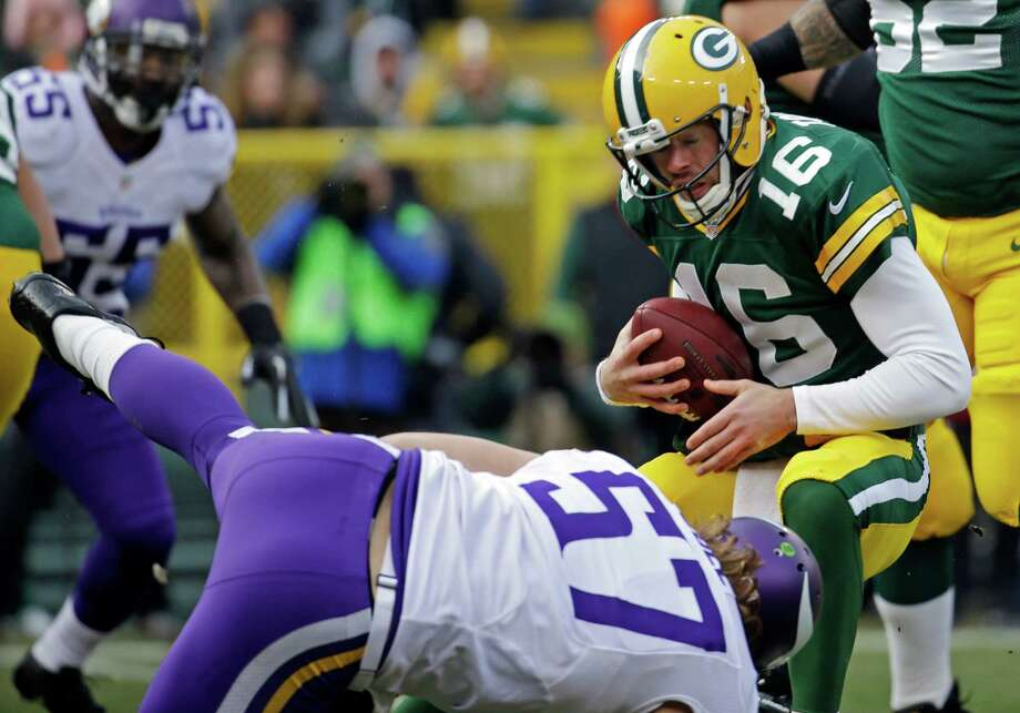 Green Bay Packers' Scott Tolzien tries to get away from Minnesota Vikings' Audie Cole during the first half of an NFL football game Sunday, Nov. 24, 2013, in Green Bay, Wis. Photo: Morry Gash, AP / AP