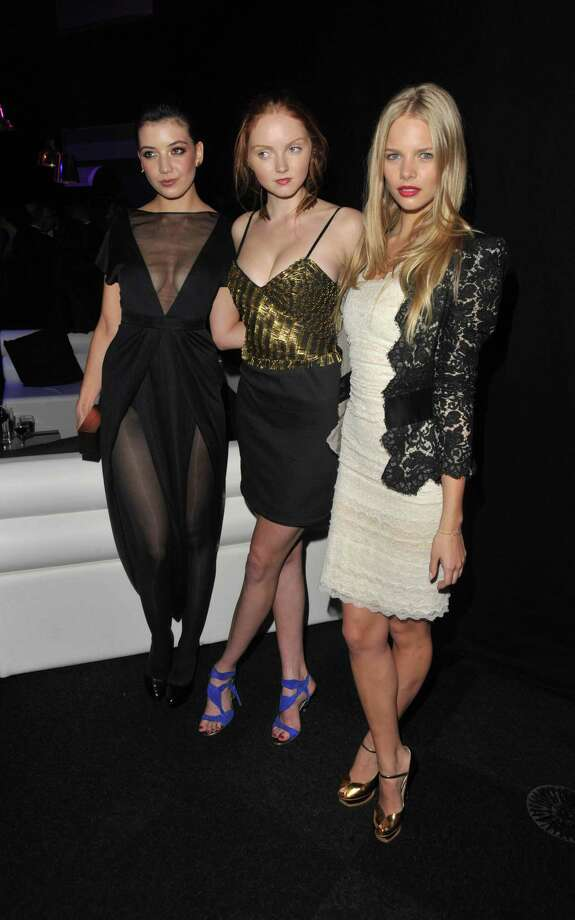 Daisy Lowe and Lily Cole and Marloes Horst attends the cocktail reception for the launch of the 2010 Pirelli Calendar at Old Billingsgate Market on November 19, 2009 in London, England.  Photo: Jon Furniss, Getty Images / 2009 Jon Furniss