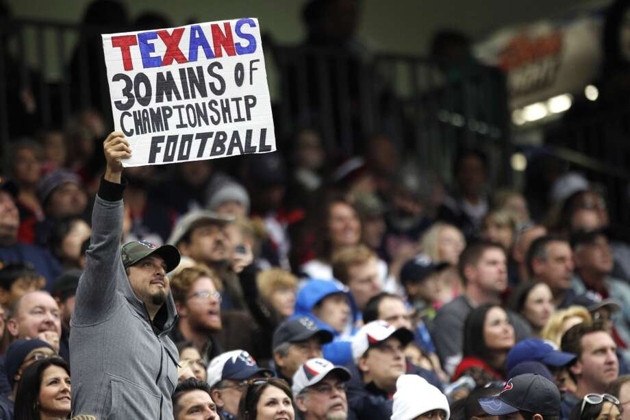 A Texans fan holds up a sign mocking the Texans' lack of production during the second half. Photo: Brett Coomer, Houston Chronicle