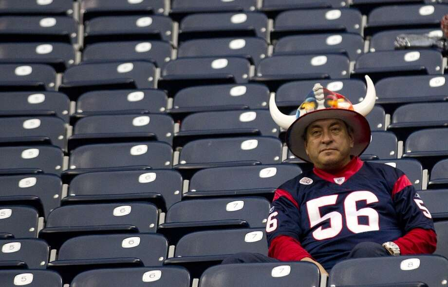 A Texans fan sits alone in the stands after the loss to the Jacksonville Jaguars at Reliant Stadium on Nov. 24. Photo: Brett Coomer, Houston Chronicle