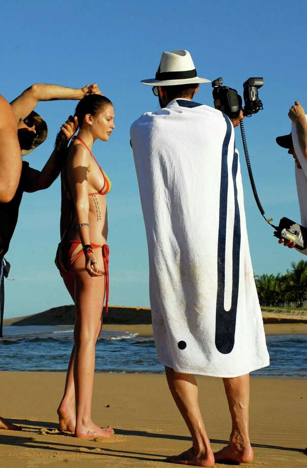 In this undated handout image provided by Pirelli, model Catherine McNeil and photographer Terry Richardson work on the creation of the new 2010 Pirelli calendar which is launched on November 20, 2009. Photo: Handout, Getty Images / 2009 Pirelli