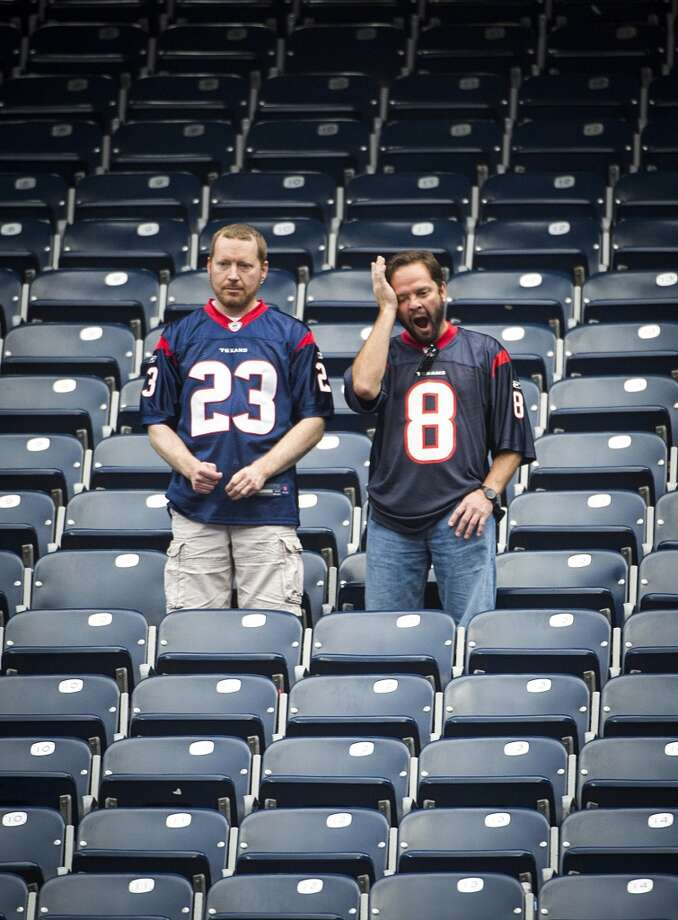 Texans fans linger in the stadium after a 28-23 loss to the Oakland Raiders at Reliant Stadium on Nov. 17. Photo: Smiley N. Pool, Houston Chronicle