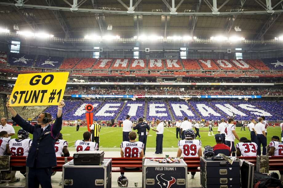 "Fans perform a card stunt to spell out ""Thank You Veterans"" during the first half of the Texans' loss to the Arizona Cardinals on Nov. 10, in Glendale, Ariz. Photo: Smiley N. Pool, Houston Chronicle"