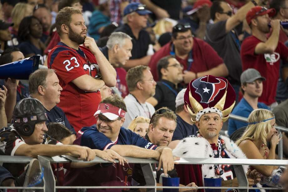 Texans fans react during the second half of the loss to the Arizona Cardinals. Photo: Smiley N. Pool, Houston Chronicle