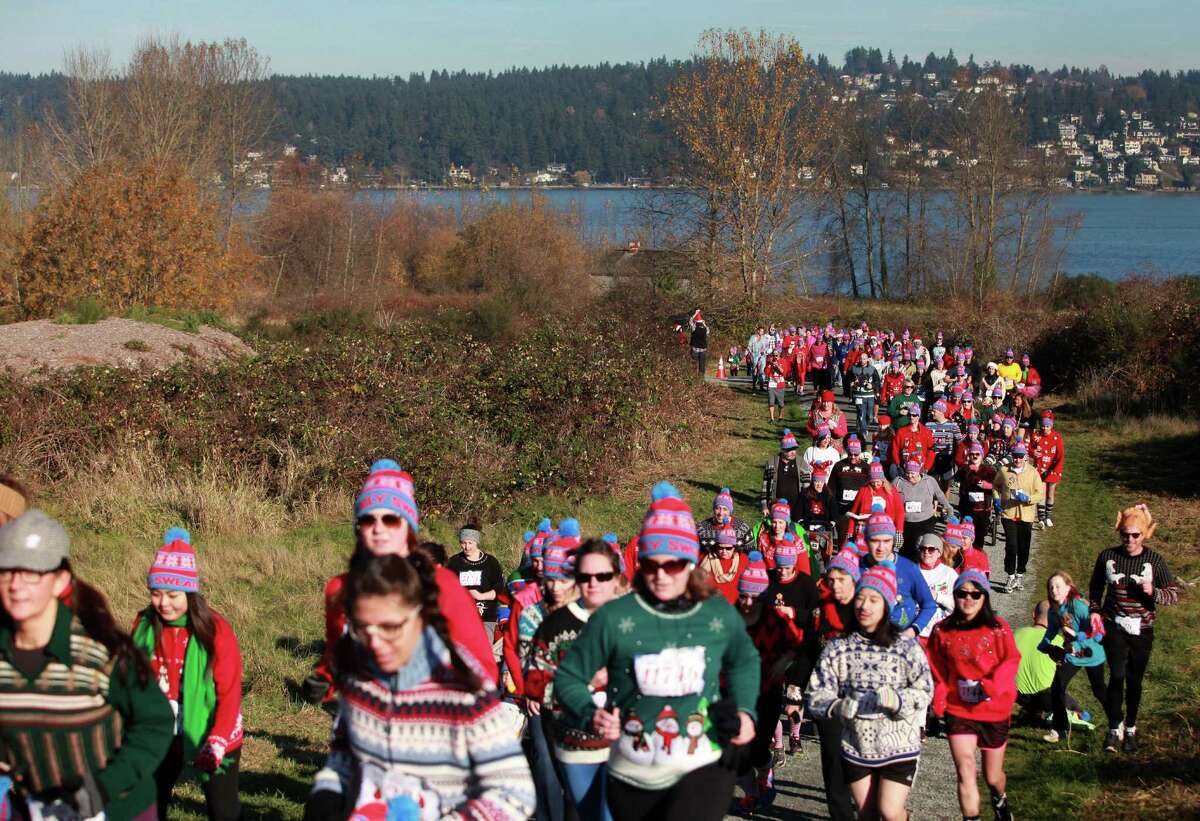 Participants are shown during the Ugly Sweater Run on Sunday, Nov. 24, 2013, at Magnuson Park in Seattle. The 5K run benefited Toys For Tots as each participant donated a new toy to the foundation.