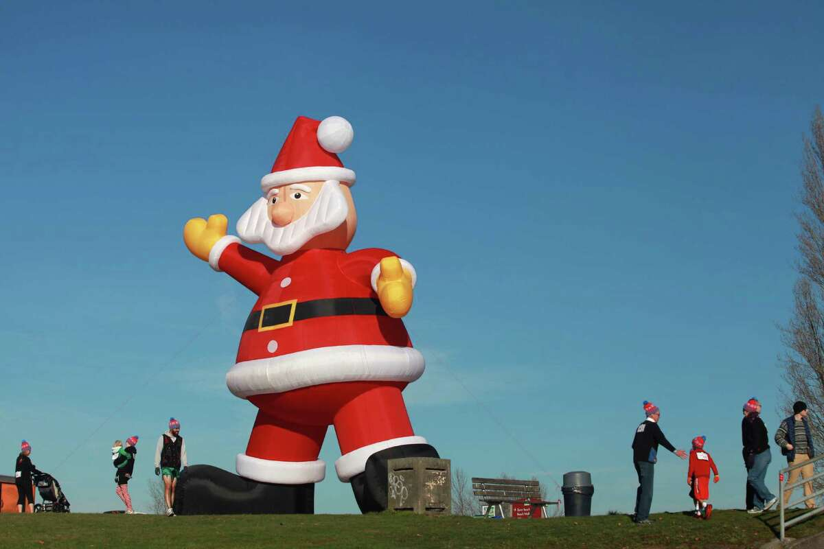 A large inflatable Santa is shown during the Ugly Sweater Run on Sunday, Nov. 24, 2013, at Magnuson Park in Seattle. The 5K run benefited Toys For Tots as each participant donated a new toy to the foundation.