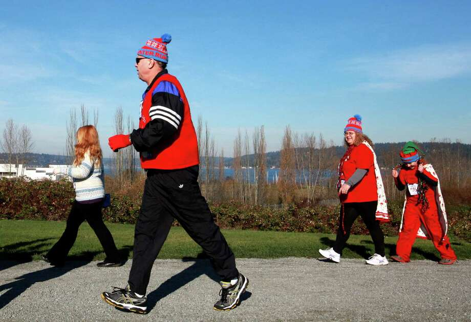 Participants are shown during the Ugly Sweater Run on Sunday, Nov. 24, 2013, at Magnuson Park in Seattle. The 5K run benefited Toys For Tots as each participant donated a new toy to the foundation. Photo: SOFIA JARAMILLO, SEATTLEPI.COM / SEATTLEPI.COM