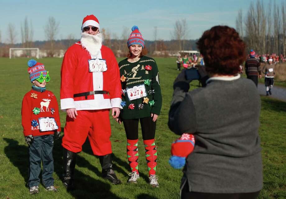 Participants pose for a photo during the Ugly Sweater Run on Sunday, Nov. 24, 2013, at Magnuson Park in Seattle. The 5K run benefited Toys For Tots as each participant donated a new toy to the foundation. Photo: SOFIA JARAMILLO, SEATTLEPI.COM / SEATTLEPI.COM