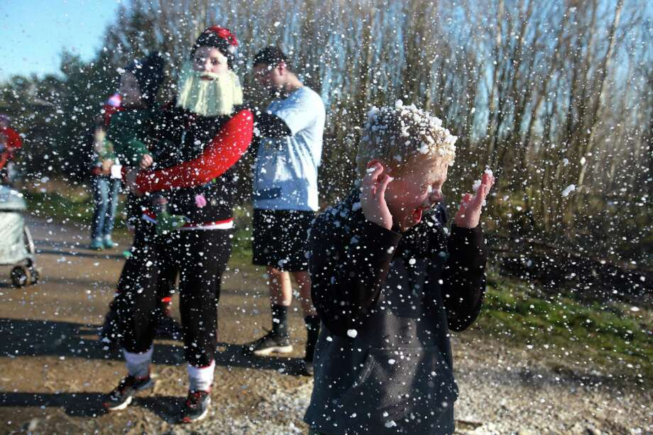 Isaac Keppner, 7, plays in fake snow during the Ugly Sweater Run on Sunday, Nov. 24, 2013, at Magnuson Park in Seattle. The 5K run benefited Toys For Tots as each participant donated a new toy to the foundation. Photo: SOFIA JARAMILLO, SEATTLEPI.COM / SEATTLEPI.COM
