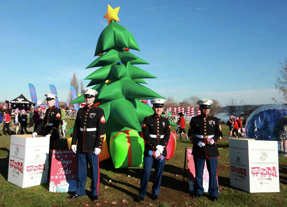 Members of the United States Marine Corps collect toys during the Ugly Sweater Run on Sunday, Nov. 24, 2013, at Magnuson Park in Seattle. The 5K run benefited Toys For Tots as each participant donated a new toy to the foundation. Photo: SOFIA JARAMILLO, SEATTLEPI.COM / SEATTLEPI.COM