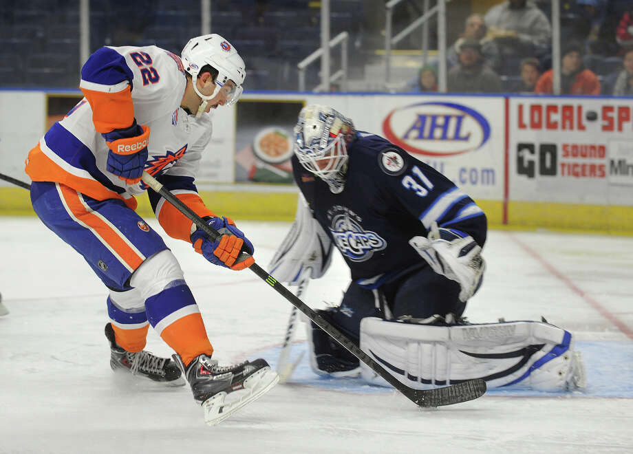 Sound Tiger Alan Quine is stopped on a breakaway by St. John's Icecaps' goalie Jussi Oklinuora in the second period of their AHL hockey matchup at the Webster Bank Arena in Bridgeport, Conn. on Sunday, November 24, 2013. Photo: Brian A. Pounds / Connecticut Post