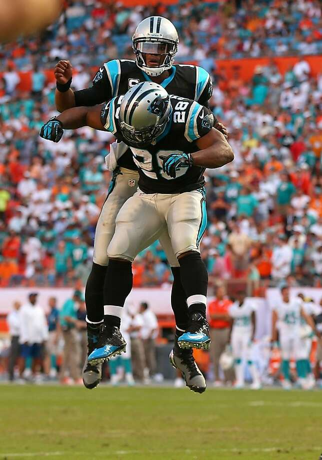 Cam Newton (rear) and Jonathan Stewart celebrate a touchdown during their comeback win in Miami. Photo: Mike Ehrmann, Getty Images