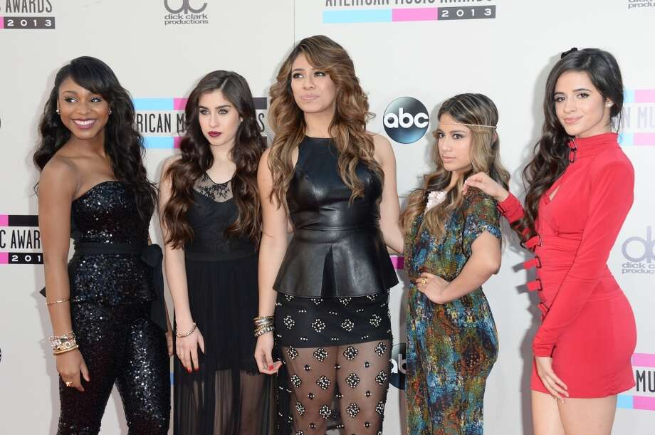 (L-R) Normani Kordei, Lauren Jauregui, Dinah Jane Hansen, Ally Brooke, and Camila Cabello of Fifth Harmony attend the 2013 American Music Awards at Nokia Theatre L.A. Live on November 24, 2013 in Los Angeles, California.  (Photo by Jason Merritt/Getty Images) Photo: Jason Merritt, Getty Images