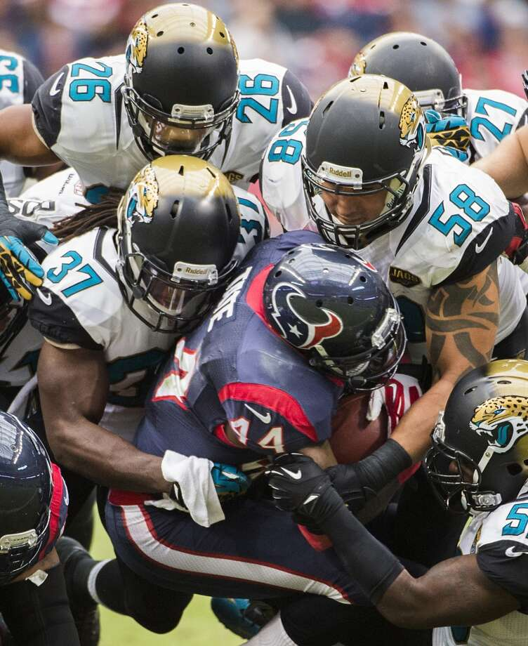 Houston Texans running back Ben Tate is stuffed by the Jacksonville Jaguars defense. Tate rushed for just a single yard on seven attempts. Photo: Smiley N. Pool, Houston Chronicle