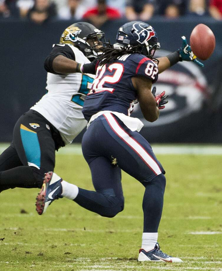 Jaguars defensive end Ryan Davis intercepts a pass intended for Texans wide receiver Keshawn Martin with 45 seconds left in the game to seal the 13-6 Jacksonville victory. Photo: Smiley N. Pool, Houston Chronicle