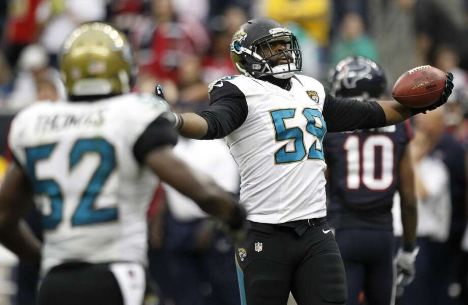Jaguars defensive end Ryan Davis celebrates his interception of a pass by Texans quarterback Case Keenum. Photo: Brett Coomer, Houston Chronicle