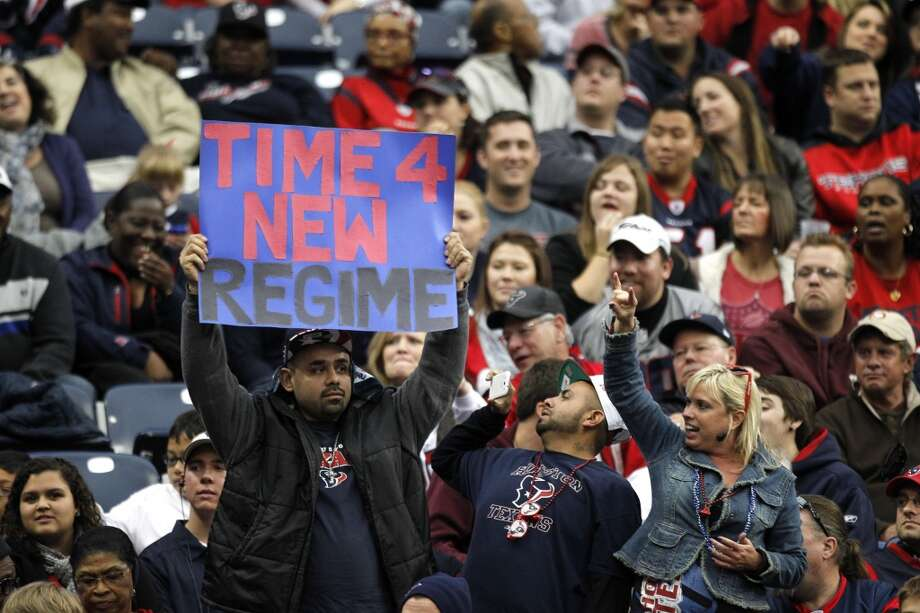 A Texans fan holds up a sign during the fourth quarter. Photo: Brett Coomer, Houston Chronicle