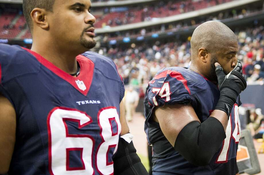 Texans offensive lineman Wade Smith (74) and  Ryan Harris (68) leave the field following a loss to the Jaguars. Photo: Smiley N. Pool, Houston Chronicle