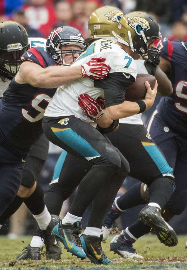 Texans defensive end J.J. Watt sacks Jacksonville Jaguars quarterback Chad Henne. Photo: Smiley N. Pool, Houston Chronicle