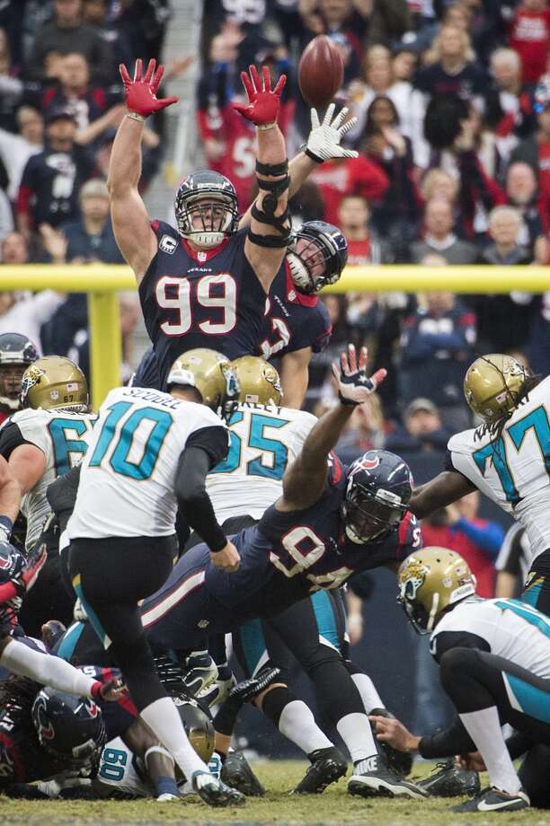 Jaguars kicker Josh Scobee kicks a 53-yard field goal over Texans defensive end J.J. Watt. Photo: Smiley N. Pool, Houston Chronicle