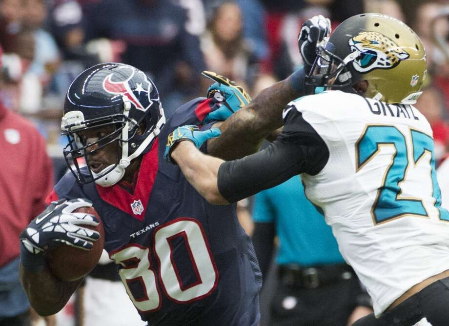 Texans wide receiver Andre Johnson tries to get gets past Jaguars cornerback Dwayne Gratz. Photo: Smiley N. Pool, Houston Chronicle