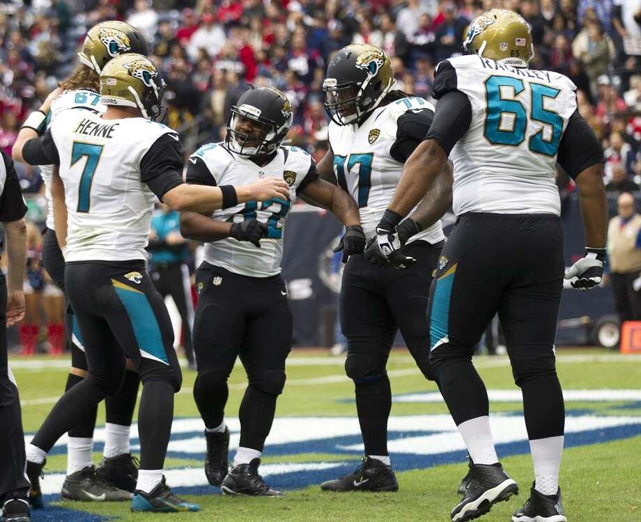 Jaguars running back Maurice Jones-Drew (32) celebrates his 1-yard touchdown run against the Texans during the first quarter. Photo: Brett Coomer, Houston Chronicle