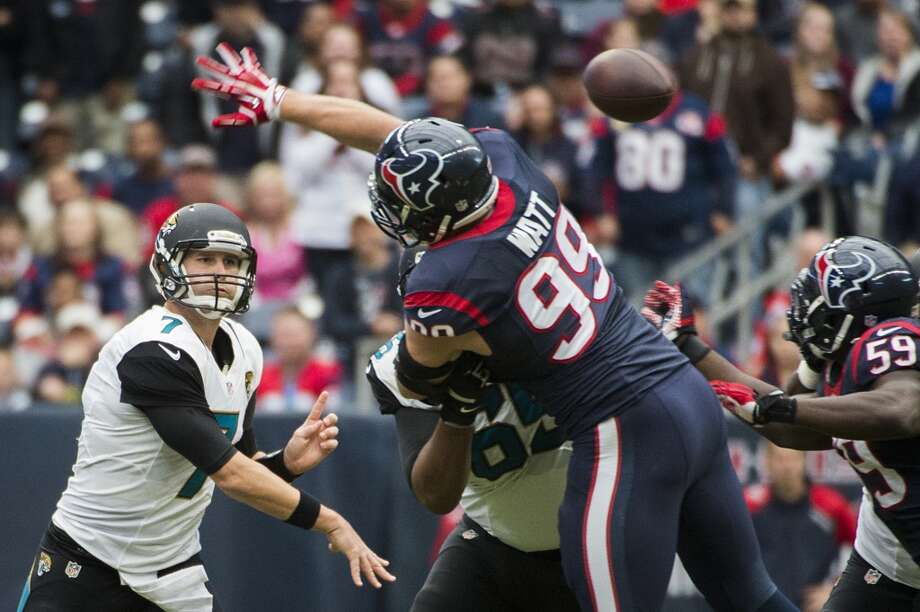 Jaguars quarterback Chad Henne gets off a pass over Texans defensive end J.J. Watt. Photo: Smiley N. Pool, Houston Chronicle