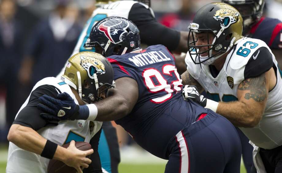 Texans nose tackle Earl Mitchell sacks Jaguars quarterback Chad Henne. Photo: Brett Coomer, Houston Chronicle