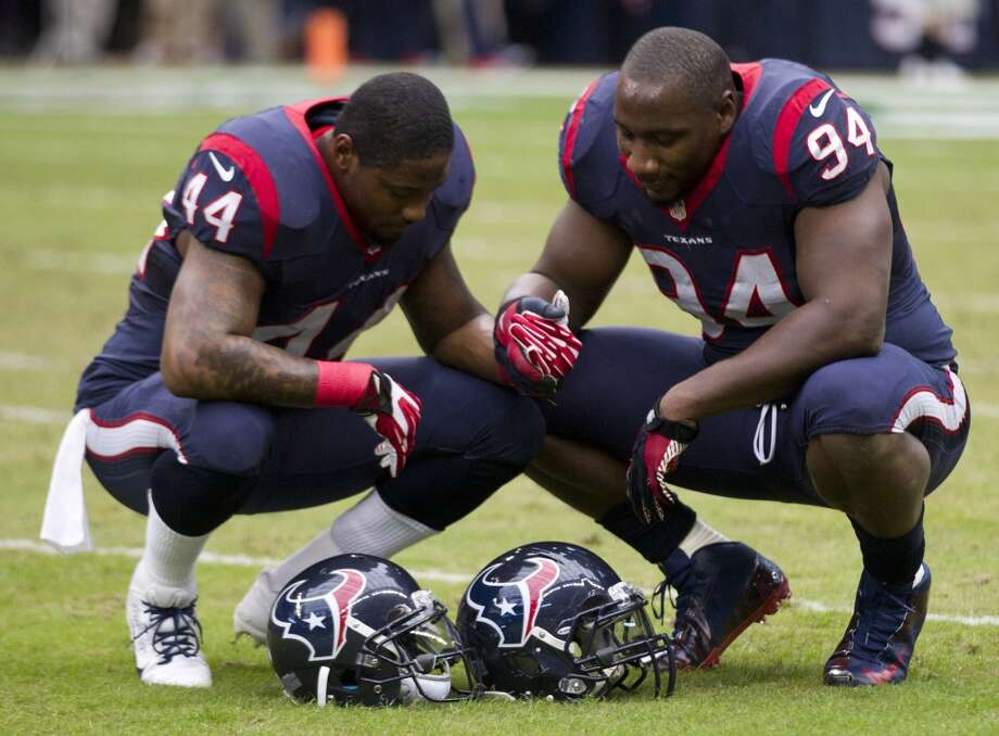 Texans running back Ben Tate (44) and defensive end Antonio Smith (94) kneel to pray before the game. Photo: Brett Coomer, Houston Chronicle