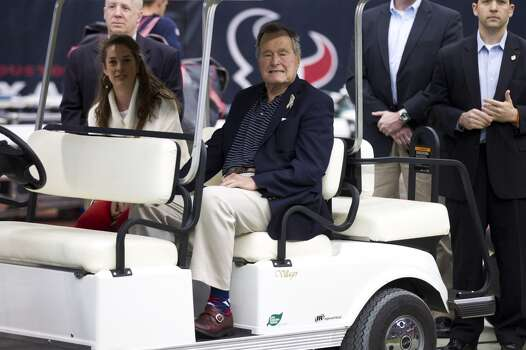 President George H.W. Bush is an avid Houston sports fan. Photo: Brett Coomer, Houston Chronicle