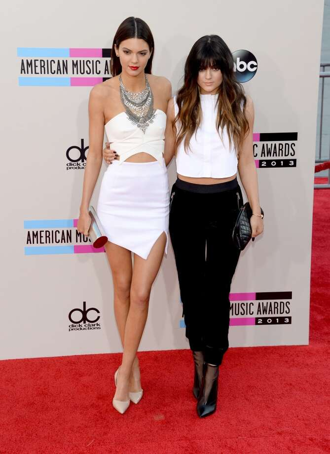 L to R) Television personalities Kendall Jenner and Kylie Jenner attend the 2013 American Music Awards at Nokia Theatre L.A. Live on November 24, 2013 in Los Angeles, California.  (Photo by Jason Kempin/Getty Images) Photo: Jason Kempin, Getty Images