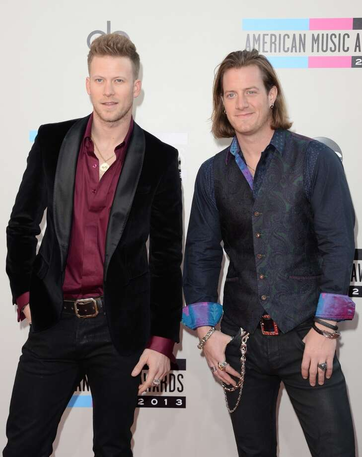 Musicians Brian Kelly and Tyler Hubbard of Florida Georgia Line attend the 2013 American Music Awards at Nokia Theatre L.A. Live on November 24, 2013 in Los Angeles, California.  (Photo by Jason Merritt/Getty Images) Photo: Jason Merritt, Getty Images