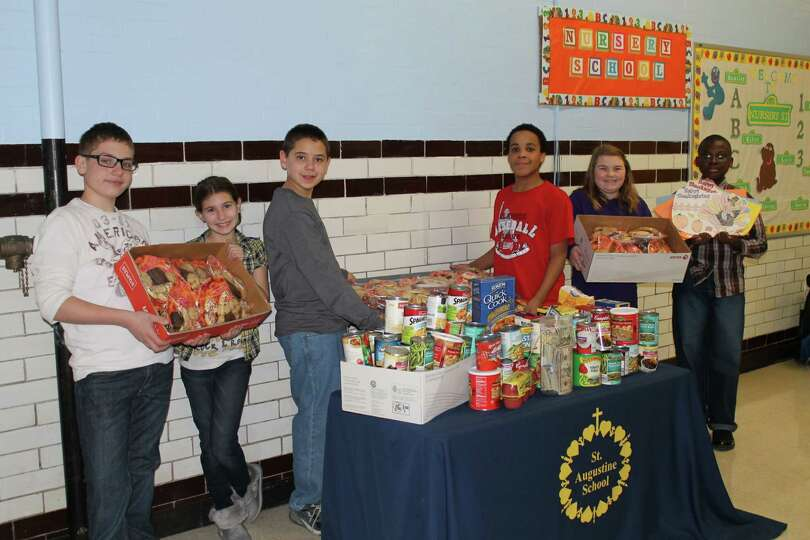 Students from St. Augustine's School in Troy, along with the St. Augustine's Parish Good Works Youth