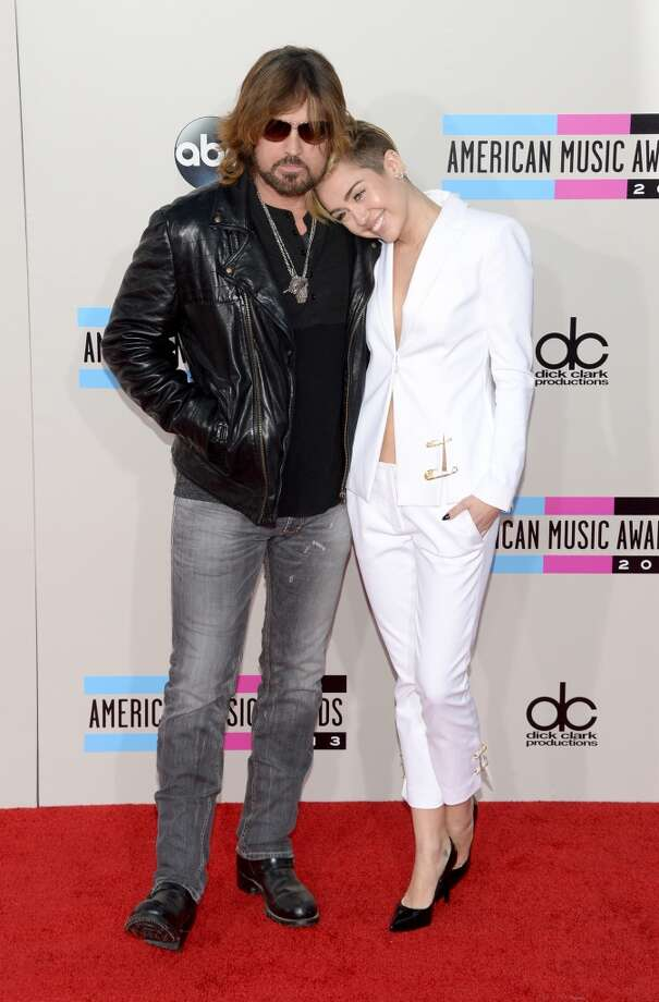 Singers Billy Ray Cyrus and Miley Cyrus attend the 2013 American Music Awards at Nokia Theatre L.A. Live on November 24, 2013 in Los Angeles, California.  (Photo by Jason Kempin/Getty Images) Photo: Jason Kempin, Getty Images