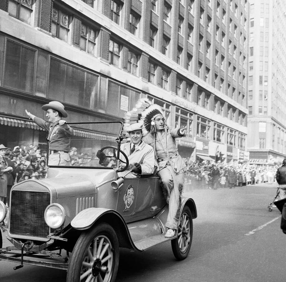 A car drives by with Howdy Doody characters Bob Smith as Buffalo Bob Smith and Bill LeCornec as Chief Thunderthud during the 1954 Macy's Thanksgiving Day Parade. Photo: NBC, Getty Images / © NBC Universal, Inc.