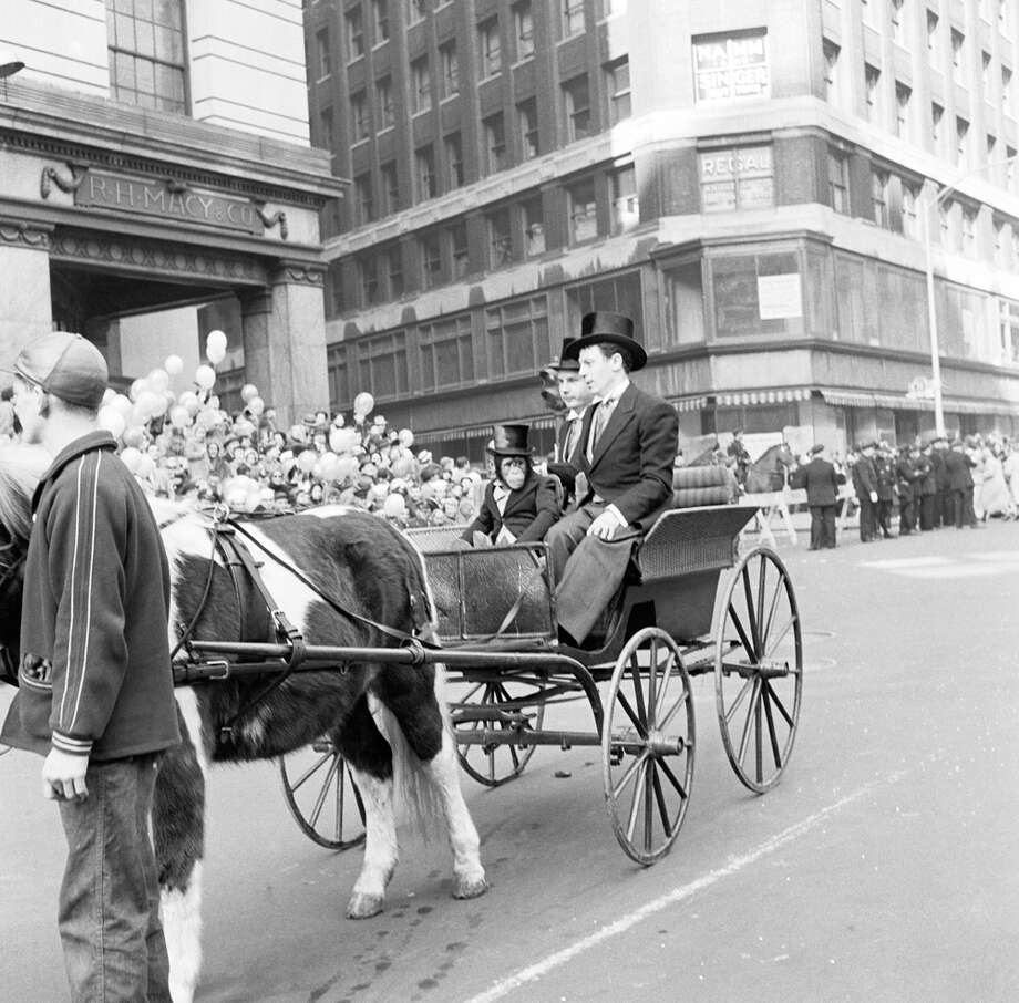 A horse and carriage carrying a chimpanzee is seen during the 1954 Macy's Thanksgiving Day Parade. Photo: NBC, Getty Images / © NBC Universal, Inc.