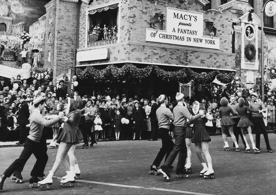 "Rollerskating teens perform during the Macy's Thanksgiving Day Parade in New York City on Nov. 26, 1961. The sign behind reads ""Macy's Presents a Fantasy of Christmas in New York."" Photo: Archive Photos, Getty Images / 2011 Getty Images"