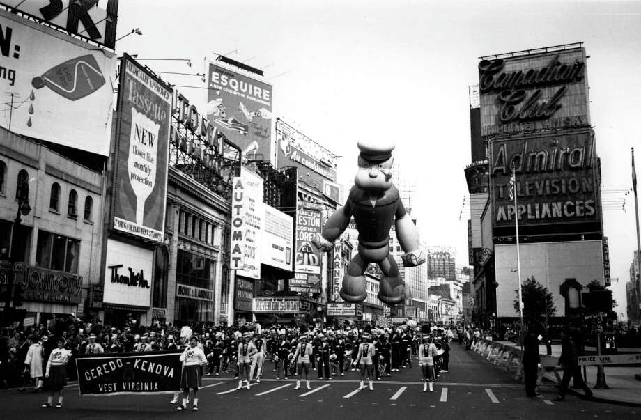 Popeye floats above the majorettes during a Macy's Thanksgiving Day Parade, circa 1960. Popeye made his Macy's debut in 1957. Photo: Express Newspapers, Getty Images / Hulton Archive