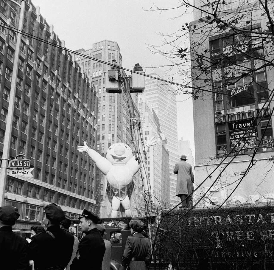 A Mighty Mouse balloon passes overhead during the 1954 Macy's Thanksgiving Day Parade. Mighty Mouse joined the parade in 1951. Photo: NBC, Getty Images / © NBC Universal, Inc.