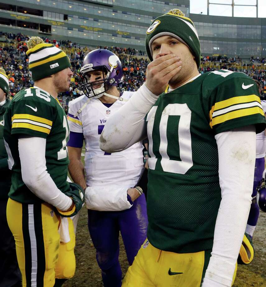 Green Bay Packers' Matt Flynn (10) covers his face as Scott Tolzien (16) talks to Minnesota Vikings' Christian Ponder after an NFL football game Sunday, Nov. 24, 2013, in Green Bay, Wis. The game ended in a tie, 26-26. (AP Photo/Jeffrey Phelps)  ORG XMIT: WIMG125 Photo: Jeffrey Phelps / FR59249 AP