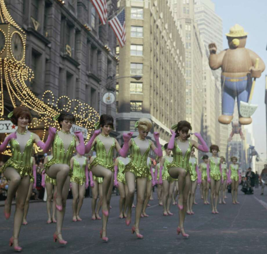 The Rockettes perform while the Smokey Bear balloon makes its debut during the 1966 Macy's Thanksgiving Day Parade. Photo: NBC, Getty Images / © NBC Universal, Inc.