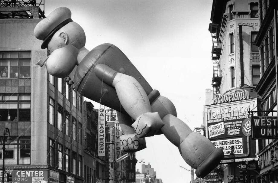 Popeye floats above the Macy's Thanksgiving Day Parade in New York as it nears Times Square on Nov. 26, 1961. Photo: William Lovelace, Getty Images / Hulton Archive