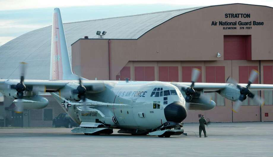 Members of the 109th Airlift Wing start the engines for the annual support mission for the National Science Foundation flight to Antarctica at the Stratton Air National Guard Base in Scotia, N.Y. Oct 16, 2012.       (Skip Dickstein/Times Union) Photo: Skip Dickstein / 00019679A