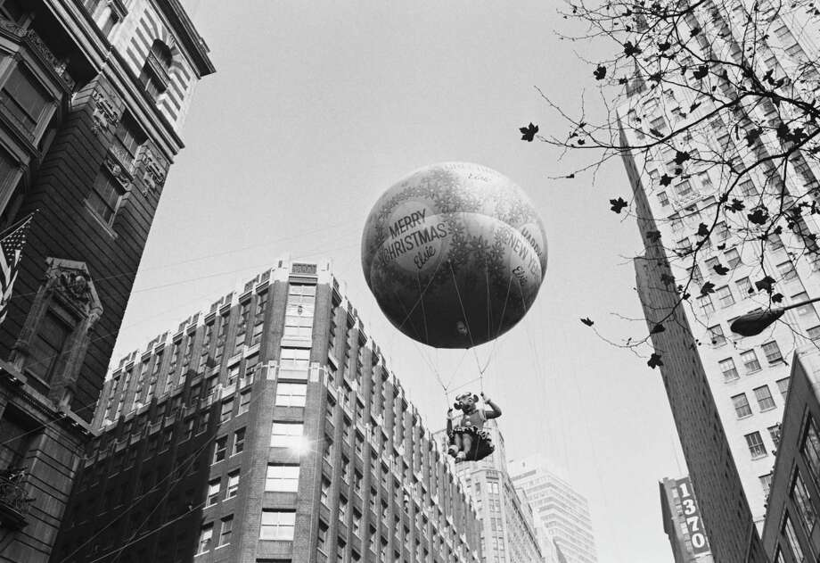 A Christmas balloon passes overhead during the 1966 Macy's Thanksgiving Day Parade. Photo: NBC, Getty Images / © NBC Universal, Inc.