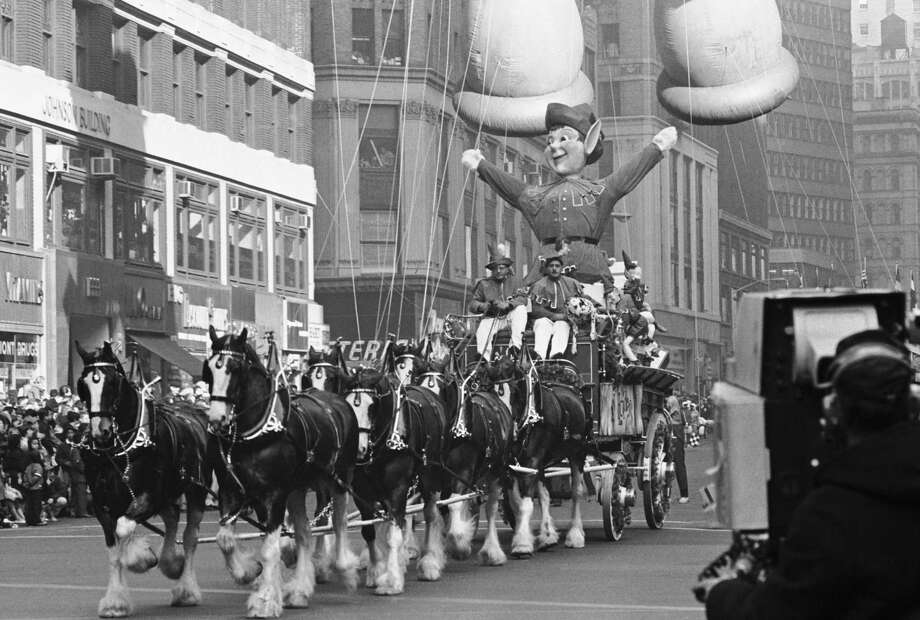 A horse-drawn holiday float passes by the crowd during 1966 Macy's Thanksgiving Day Parade. Photo: NBC, Getty Images / © NBC Universal, Inc.