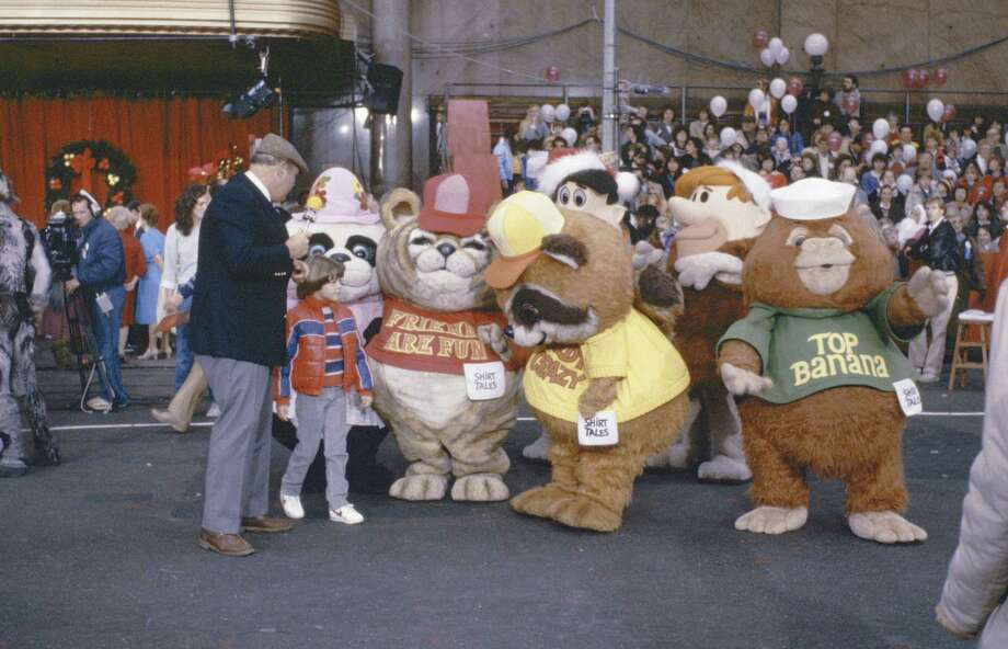 "Host Willard Scott and actor Joey Lawrence are joined by characters from ""Shirt Tales"" and ""The Flinstones"" during the 1983 Macy's Thanksgiving Day Parade. Photo: NBC, Getty Images / © NBC Universal, Inc."