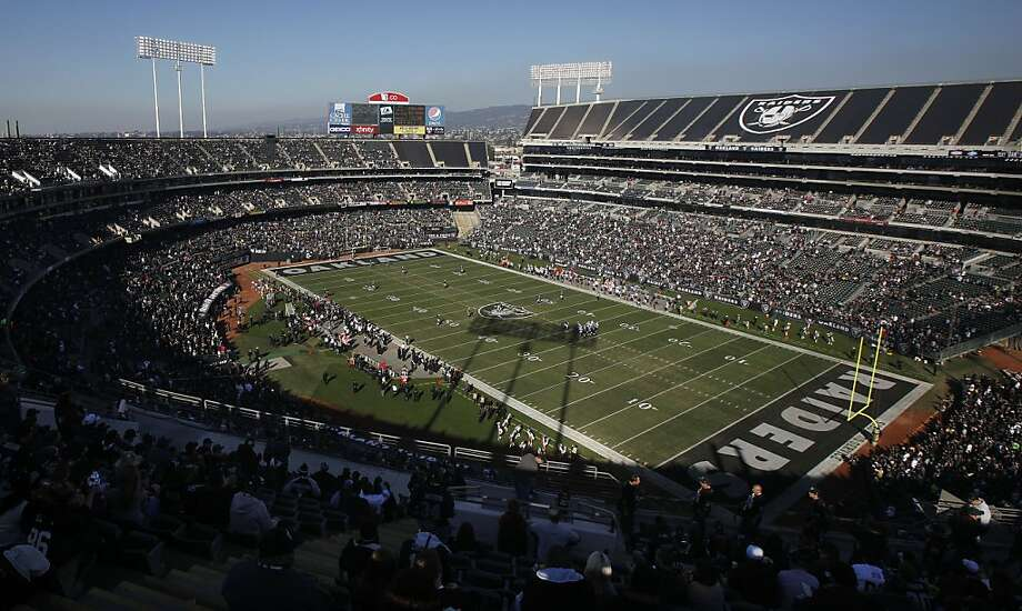 Fans at O.co Coliseum watch as the Oakland Raiders play the Tennessee Titans during the first quarter of an NFL football game in Oakland, Calif., Sunday, Nov. 24, 2013. Photo: Beck Diefenbach, Associated Press