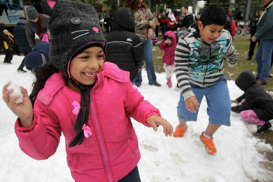 Josilin Contreras, 6, plays in snow during the Fire and ICE Carnival at Discovery Green, 1500 McKinney, Sunday, Nov. 24, 2013, in Houston.   Other events included fire-breathing art cars, music, ice carving, ice skating performances, and the opportunity to carve names in a 10-foot-wall of ice. Photo: Melissa Phillip, Houston Chronicle / © 2013  Houston Chronicle
