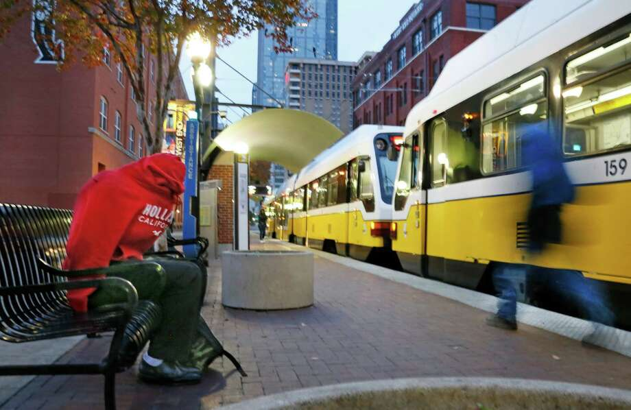 Keunte Williams huddles in his hoodie as he waits for his train at the DART station off near the West End in downtown Dallas, as an arctic cold front begins to move into the North Texas area on Sunday, November 24, 2013.  (Louis DeLuca/Dallas Morning News) Photo: Louis DeLuca, Staff Photographer / 00020033A